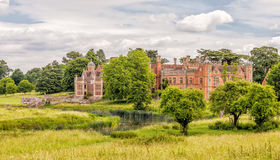 Charlecote House and Deer Park, Warwickshire, England. A rear view of the House and on the left the steps that lead down from the garden to the River Avon Royalty Free Stock Photo