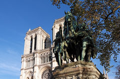 Charlemagne statue and Notre Dame cathedral Stock Photo