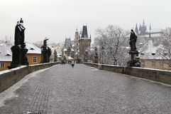 Charles bridge. Only few visitors on Charles bridge in a snowy morning, Prague, Czech stock image