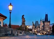 Free Charles Bridge At Dawn, Silhouette Of Bridge Tower And Saint Sculptures With Lit Street Light Lamp In Prague, Czech Republic Royalty Free Stock Images - 169978919
