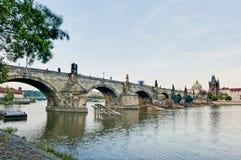 Charles Bridge crossing Vltava river. Royalty Free Stock Photo