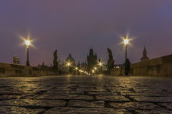 Charles Bridge at Dawn. The Charles Bridge at dawn (Czech: Karlův most is a famous historic bridge that crosses the Vltava river in Prague, Czech Republic. Its Royalty Free Stock Image
