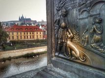 Charles Bridge Detail. Brass rubbing dog detail with Prague Castle Royalty Free Stock Photos