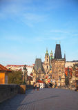 Charles bridge early in the morning with tourists Royalty Free Stock Photo