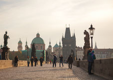 Charles bridge early in the morning with tourists Stock Photography
