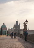 Charles bridge early in the morning with tourists Royalty Free Stock Photography