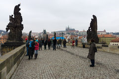 The Charles Bridge is a famous historic bridge that crosses the Vltava river in Prague Royalty Free Stock Images