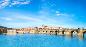 Charles Bridge and historical buildings in Prague from across th Royalty Free Stock Image