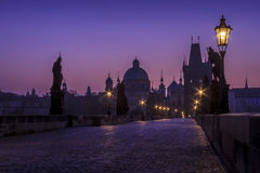 The Charles Bridge just before sunrise. With street lights  and no crowds in Prague, Czech Republic Stock Photography