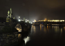 Charles bridge landmark in Prague by night Stock Photo