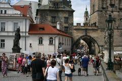 Charles Bridge_Little Quarter side tower_IV. The Charles Bridge ( Karlův most) is a famous historic bridge that crosses the Vltava river in Prague, Czech Stock Photos