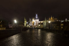 Charles bridge at night with the Prague castle and st. Vitus Cathedral Royalty Free Stock Photo