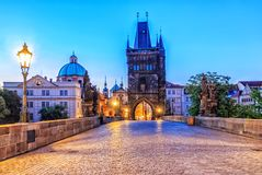 Charles bridge and Old Town of Prague in morning twilight stock photos