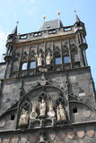 Charles Bridge_Old Town side tower. The Charles Bridge ( Karlův most) is a famous historic bridge that crosses the Vltava river in Prague, Czech Republic. Its Royalty Free Stock Photography