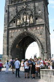 Charles Bridge_Old Town side tower. The Charles Bridge ( Karlův most) is a famous historic bridge that crosses the Vltava river in Prague, Czech Republic. Its Stock Photo