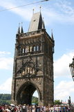 Charles Bridge_Old Town side tower. The Charles Bridge ( Karlův most) is a famous historic bridge that crosses the Vltava river in Prague, Czech Republic. Its Stock Photos