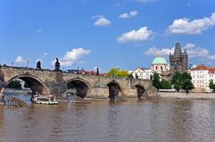 Charles Bridge, Old Town Tower and the Church of  Francis of Assisi. Prague, Czech Republic, UNESCO. View from the Vltava River to Charles Bridge, the Old Town Royalty Free Stock Photos