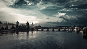 Charles Bridge over the river before the storm. The Charles Bridge is a famous historic bridge that crosses the Vltava river in Prague, Czech Republic. Its Royalty Free Stock Photos