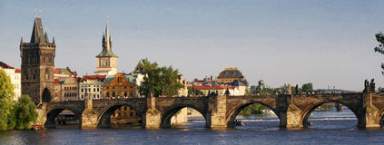 Charles Bridge in Prague. With buildings and river Royalty Free Stock Image