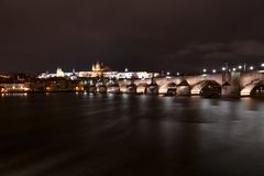 The Charles Bridge in Prague with the castle in the background l stock images
