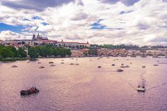 Charles Bridge Prague castle and St Vitus Cathedral. A view over Prague with Charles Bridge, Prague castle and St. Vitus Cathedral and vessels on the Vltava royalty free stock photos