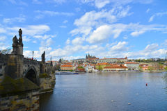 Charles Bridge and the Prague castle. In a sunny day Stock Images