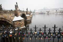Charles Bridge and Prague Castle in Winter with Padlocks in Foreground Stock Photo