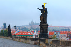 Charles Bridge in Prague at cloudy morning. Stock Photography