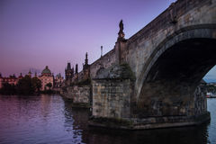 The Charles bridge in Prague, Czech Republic. Twilight violet picture of the oldest bridge in Prague, Czech republic: Charles Bridge. Medieval gothic bridge over Stock Photography