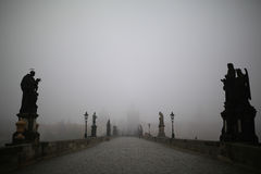 Charles Bridge in Prague at foggy morning Stock Image