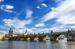 Charles bridge in Prague. Gorgeous Charles bridge in Prague against a blue sky with clouds Royalty Free Stock Photography