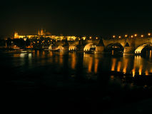 Charles Bridge in Prague at night. With Vltava river in the foreground royalty free stock photography