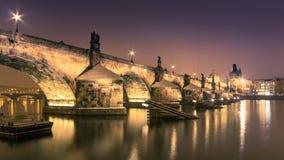 Charles bridge in Prague over Vltava river. At night Stock Photo