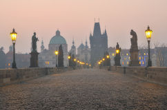 Charles Bridge in Prague during the sunrise Stock Image