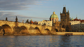 Charles bridge. And Prague tower in golden evening light Stock Photography