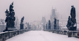 Charles Bridge, Prague. View of the iconic Charles Bridge, Prague in the snow, with Prague Castle in the background Royalty Free Stock Image
