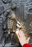 Charles Bridge Series. Touching the bronze plates on the statue of St John of Nepomuk is supposed to bring good fortune. Charles Bridge, Prague Stock Image