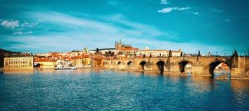 Charles Bridge, St. Vitus Cathedral and historical Prague Royalty Free Stock Photo