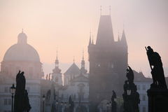 Charles bridge statues with New Town scenery Royalty Free Stock Images