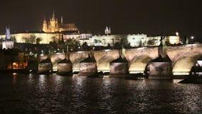 Charles Bridge (Stone Bridge, Prague Bridge)  and St. Vitus Cathedral at night. Prague. Czech Republic stock footage