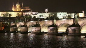 Charles Bridge Stone Bridge, Prague Bridge  and St. Vitus Cathedral at night. Prague. Czech Republic stock footage