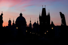 Charles Bridge at sunrise, Prague, Czech Republic. Dramatic statues and medieval towers. Royalty Free Stock Photos