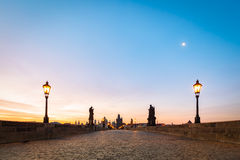 Charles Bridge at sunrise, Prague, Czech Republic. Dramatic statues and medieval towers. Royalty Free Stock Images