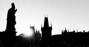 Charles Bridge at sunrise, Prague, Czech Republic. Statues and towers silhouettes Royalty Free Stock Photos