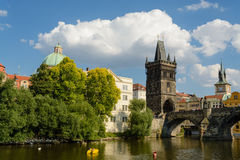 Charles bridge and Tower bridge in Prague. A view of the Charles bridge featuring the Tower bridge from the Vltava river in Prague royalty free stock photo