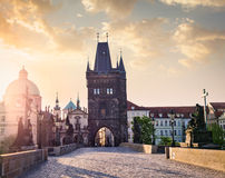 Charles bridge tower in Prague on sunrise Royalty Free Stock Photos