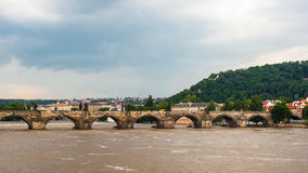 Charles Bridge. Vltava river and cloudy sky Stock Photo