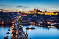 Charles Bridge on Vltava river in Prague, Czech Republic at late sunset, night. Prague Castle Royalty Free Stock Images