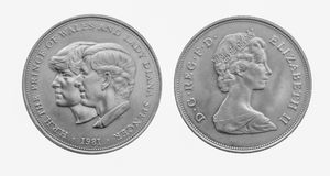 1981 Charles and Diana Royal wedding silver crown coin. 1981 Prince Charles and Diana Royal wedding silver crown coin. Front and reverse isolated on white royalty free stock photography