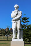 Charles Dickens. Live size marble statue of Charles Dickens in Centennial park Sydney. This is one of three statues in the world of the English novelist and Royalty Free Stock Photos